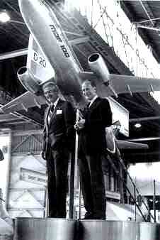 Frans Swarttouw and Sanford N. Douglas with a model of the MDF-100 at the 1981 Paris Air Show