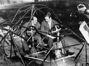 Anthony Fokker and Charles Lindbergh during a visit to the factory in Amsterdam. Fokker demonstrates the cockpit of the Fokker F.XXXVI with the remarkable position of the pilots seated behind each other