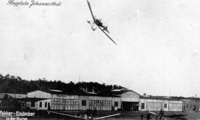 Postcard from 1913: Fokker Spider 3 with closed fusulage in a turn over Fokker Military Flyingschool in Johannisthal