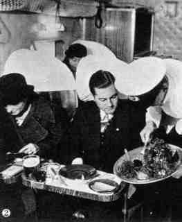 Diner is served in the Fokker F-XII on his way to Batavia